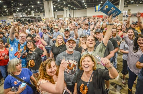 A crowd of happy people at the Denver Great American Beer Festival