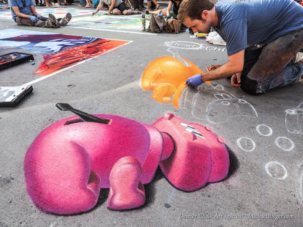 Denver chalk art festival artist drawing hippos