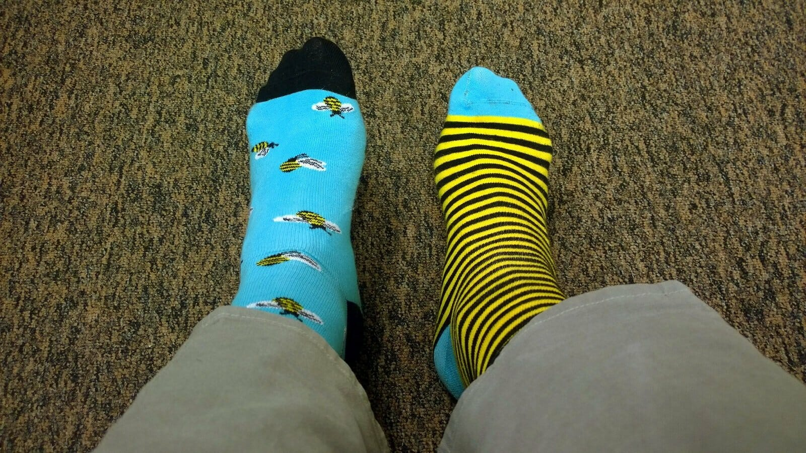 Funny travel stories - a person looking down at their mismatched socks