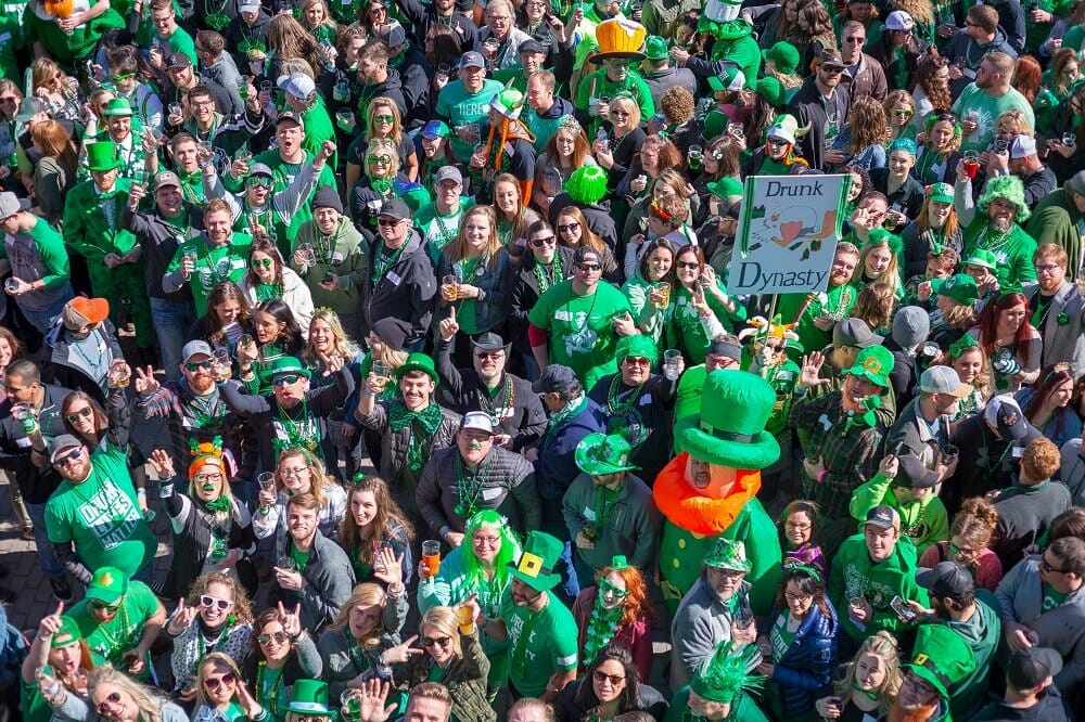 Deadwood SD Events - an aerial view of a large group of st patrick's day attendees dressed in green