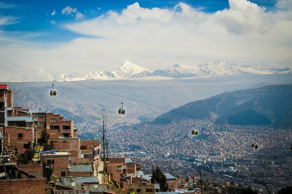 Cable car lines in the city of La Paz Bolivia with white mountains in the background