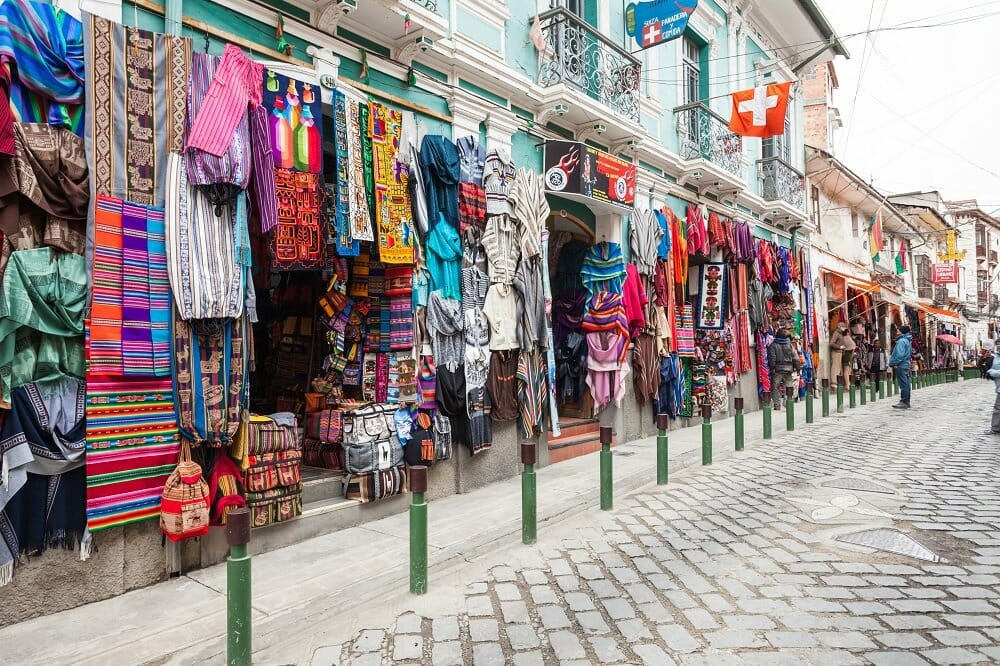 A street in La Paz, Bolivia is lined with markets selling colorful pieces