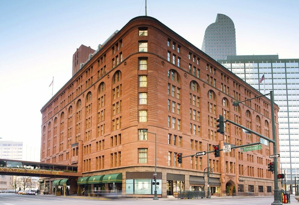 The Brown Palace in Denver; a large, red brick, triangular shaped historic building
