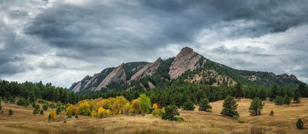 flat iron moutain in Chautauqua Park under gray rain clouds