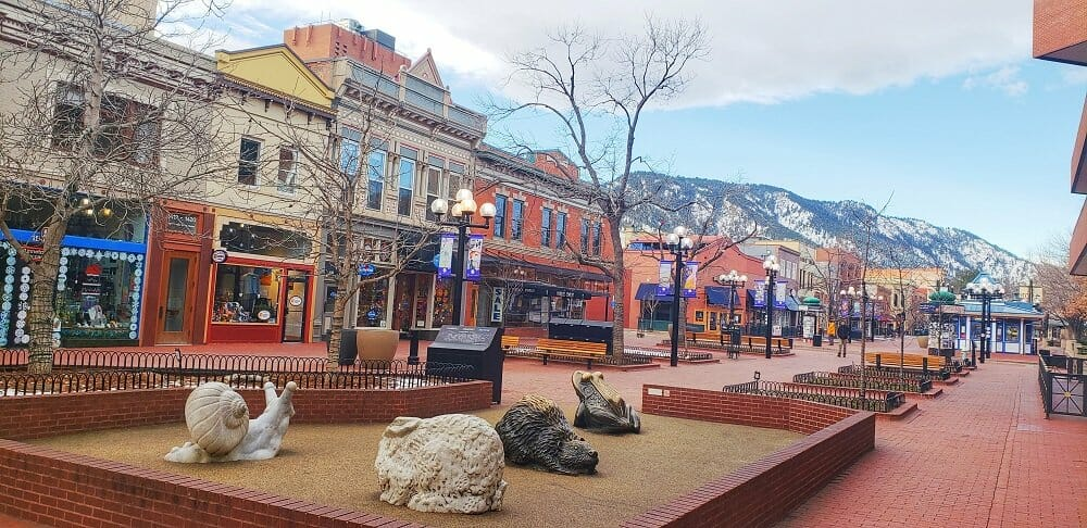Buildings, trees and art pieces line Boulder's famous Pearl Street Mall