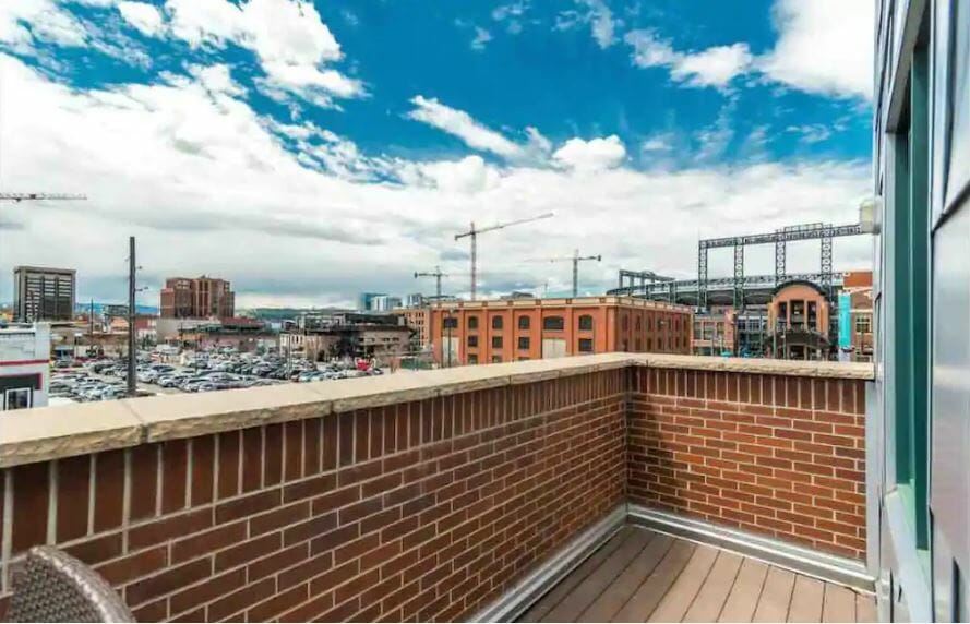 view of downtown denver and coors field from private patio