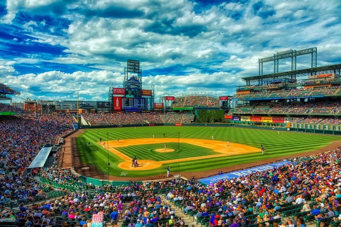 View of Coors Field in Denver CO, fans in their seats, a blue but cloudy sky