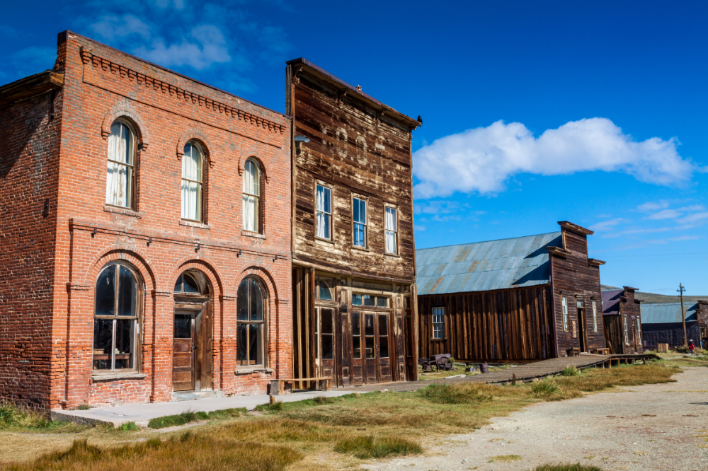 "Old wood and brick buildings of an abandoned ""ghost town"""
