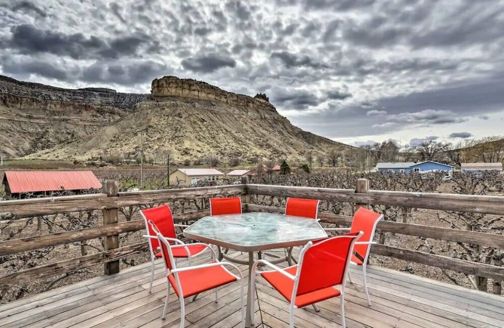 patio seating on a deck with incredible mountain views beyond