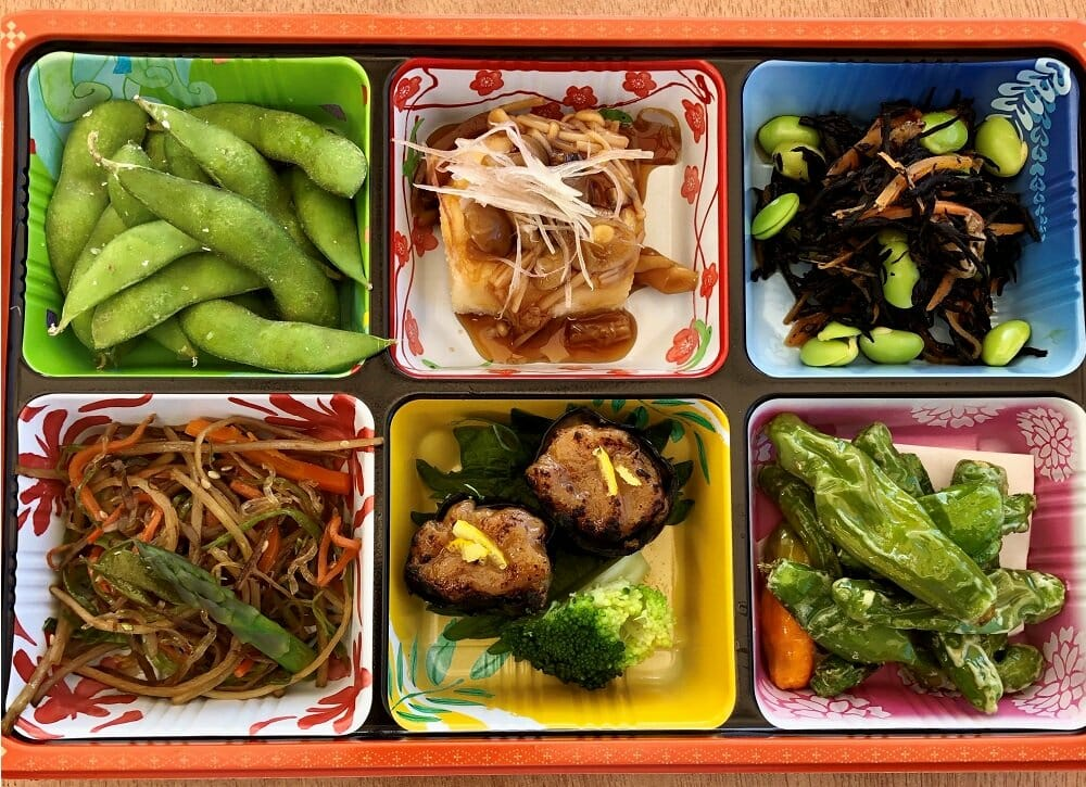 Colorful bento box with six small dishes at Ototo Den in Denver