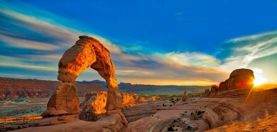 A very colorful photo of Arches National Park in Utah; sun setting in the west