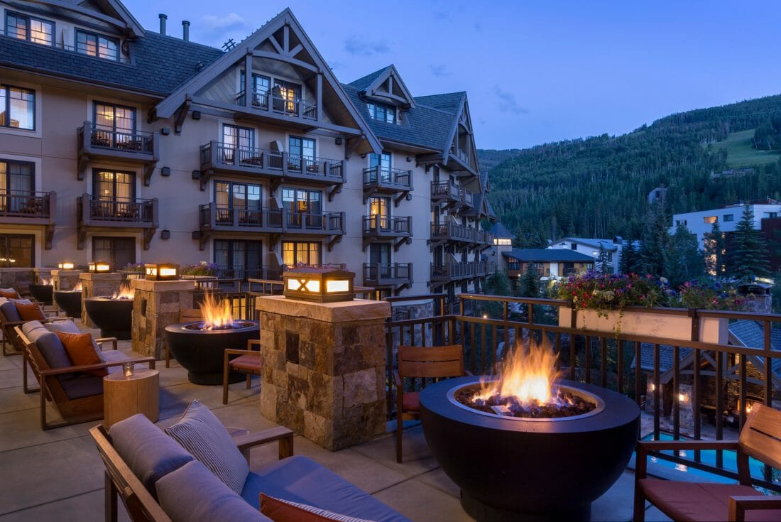 Romantic getaways in Colorado at the Four Seasons Resort Vail with outdoor seating and fire pits